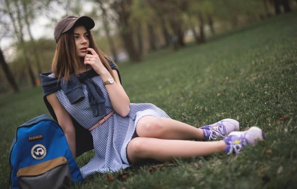 Picture girl, trees, Park, lawn, makeup, dress, hairstyle, cap, brown hair, bag, jacket, sitting, backpack, sneakers, …