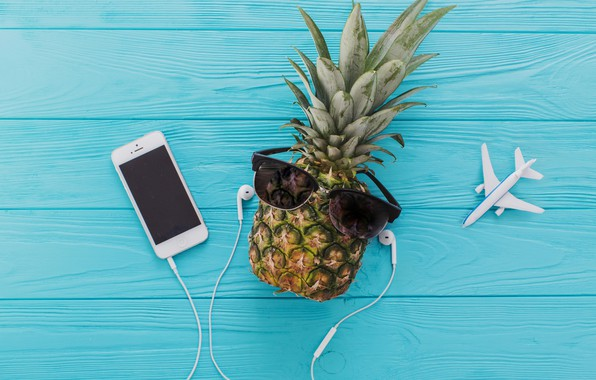Picture the plane, blue, headphones, glasses, pineapple, wooden background