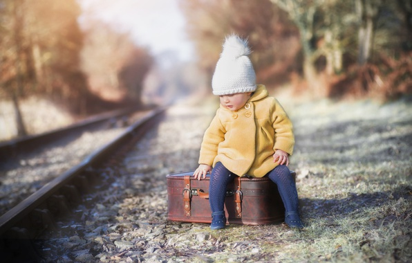 Picture girl, railroad, suitcase