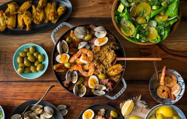 Picture lemon, orange, eggs, meat, olives, salad, shrimp, shellfish, paella