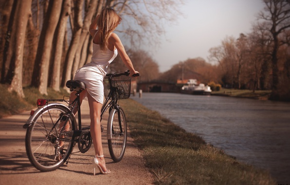 Picture girl, the sun, trees, nature, bike, pose, Park, figure, dress, hairstyle, shoes, legs, river, in …