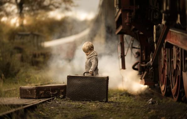 Picture train, boy, suitcases