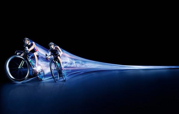 Picture movement, race, trail, speed, track, black background, cyclists, men, athletes, bikes, hats, triathlon, Triathletes