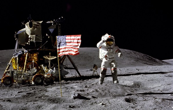 Picture the moon, flag, astronaut