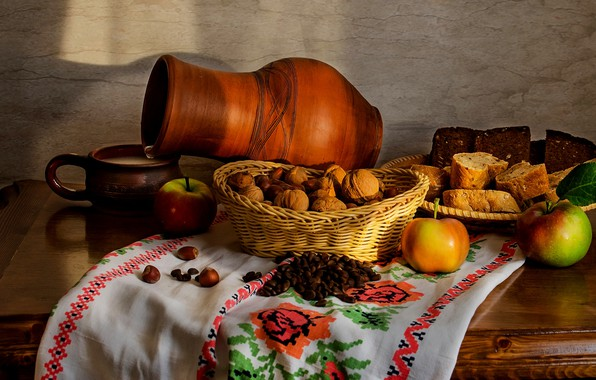Picture apples, milk, nuts, bread. pitcher