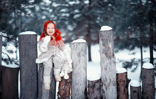 Picture winter, snow, joy, smile, mood, toy, girl, logs, shawl, bagel, sheepskin