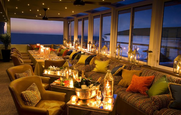 Picture the evening, candles, glasses, lights, the hotel, champagne, Australia, Twelve Apostles Hotel
