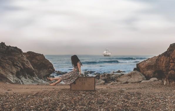 Picture sea, pebbles, rocks, ship, sailboat, girl, suitcase