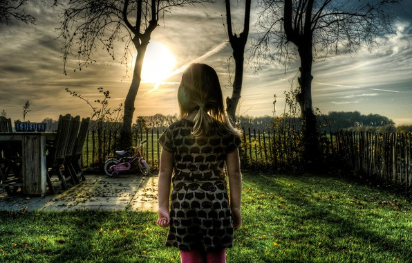 Picture the sky, grass, the sun, trees, sunset, bike, childhood, the fence, yard, Girl
