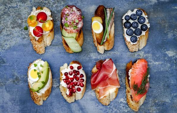 Picture berries, fish, cheese, vegetables, sandwiches, ham, salami, bruschetta, brushetta