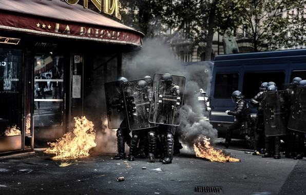 Picture the city, fire, street, smoke, police, Chaos, shields, riots