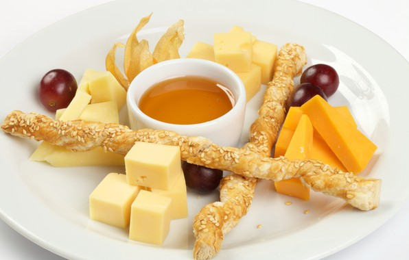 Picture cheese, honey, grapes, cuts