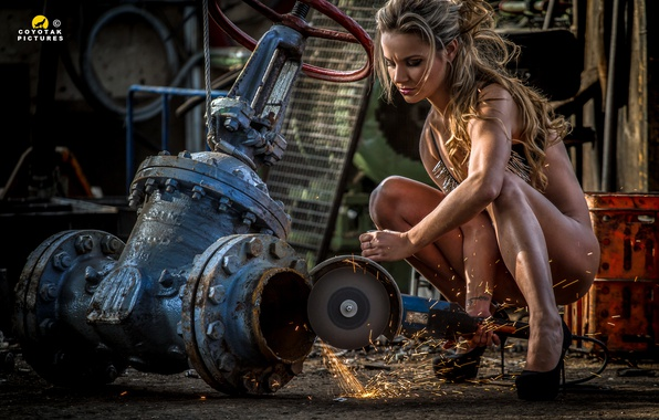 Picture Woman, chains, working, sparks, grinder, wrench Sluice