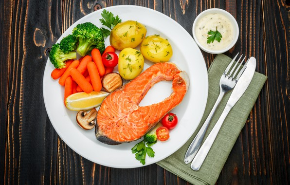 Picture greens, table, fish, plate, knife, plug, vegetables, tomatoes, carrots, sauce, napkin, potatoes