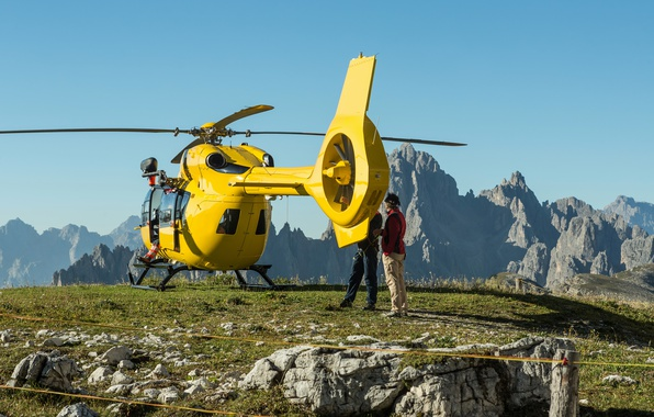 Picture the sky, grass, the sun, landscape, mountains, yellow, stones, people, rocks, helicopter, hill