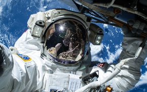 Picture the suit, Earth, ISS, astronaut