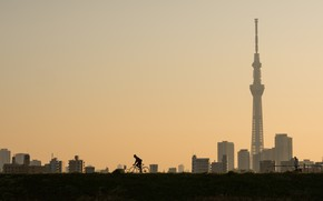 Picture the city, tower, cyclist