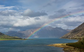 Picture sea, the sky, mountains, rainbow