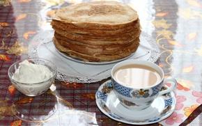 Picture tea, pancakes, sour cream