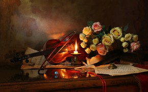 Picture notes, pen, violin, roses, candle, ring