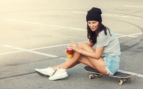 Picture asphalt, girl, glass, hat, shorts, figure, brunette, t-shirt, cocktail, legs, skate, sneakers, skateboard