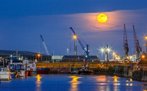 Picture sea, the moon, the evening, port, cranes