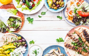 Picture fish, meat, vegetables, olives, salad, cuts, pita, kebab
