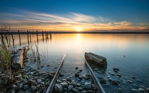 Picture the sky, grass, the sun, clouds, landscape, nature, lake, stones, dawn, shore, calm, rails, morning, …