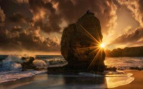 Picture sea, the sky, the sun, clouds, rays, stones, rocks, dawn, coast, horizon, surf