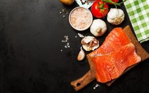 Picture fish, black background, tomatoes, garlic, salt, salmon