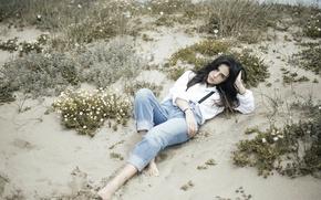 Picture sand, beach, pose, jeans, brunette, lies, shirt, curls