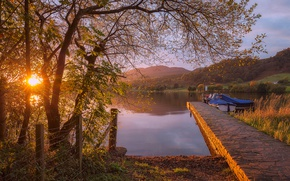 Picture the sun, trees, sunset, lake, the fence, boats, pier, Scotland, Lake of Menteith