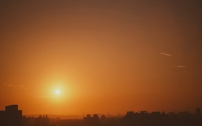 Picture the sky, the sun, the city, dawn, building, home, orange