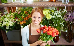 Picture look, girl, flowers, bouquet, hairstyle, tulips, red, cute, keeps, redhead, apron, shelves, smiling