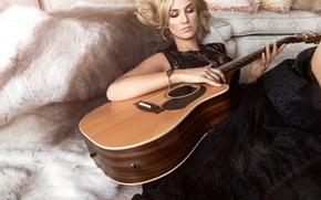 Picture guitar, singer, Delta Goodrem