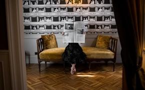 Picture girl, sofa, newspaper
