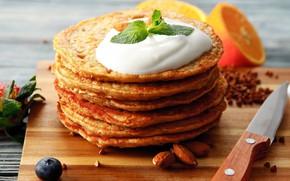Picture orange, cream, mint, almonds, pancakes