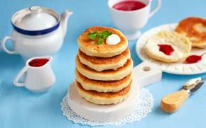 Picture jam, sour cream, syrniki