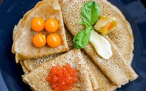 Picture pancakes, caviar, physalis, sour cream