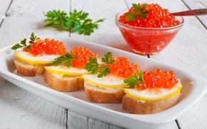 Picture lemon, bread, parsley, red caviar, buterbrodi
