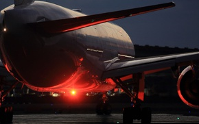 Picture the airfield, the plane, passenger, B777
