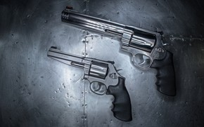Picture background, pair, revolvers