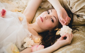 Picture look, girl, flowers, brunette, bed, fabric, the bride