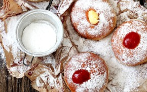 Picture donuts, jam, powdered sugar