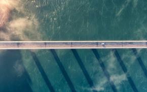 Picture car, sea, bridge, clouds, shadows