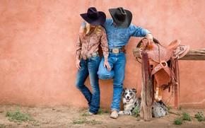 Picture woman, dog, man, cowboys, saddle