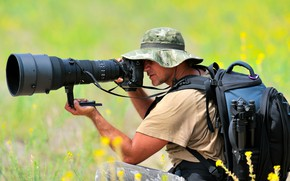 Picture photographer, man, professional, photo camera, magnifying glasses