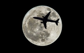 Picture the plane, the moon, satellite, silhouette