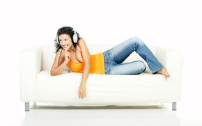 Picture girl, smile, jeans, headphones, Mike, brunette, hairstyle, white background, lies, on the couch, barefoot