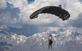 Picture the sky, mountains, army, soldiers, parachute, landing